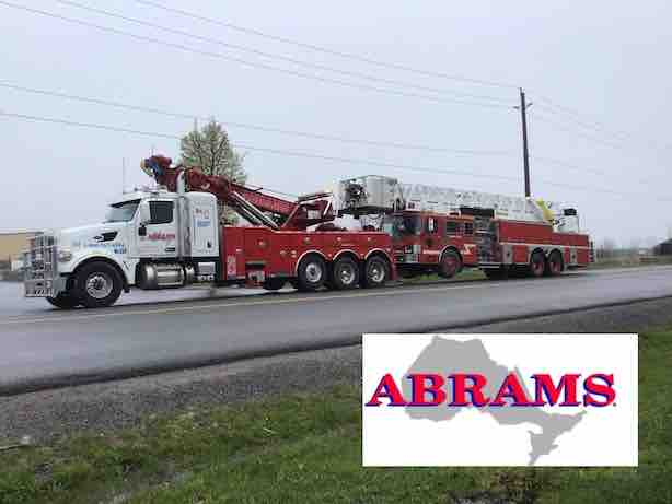 Fire truck receiving a heavy tow to Port Perry