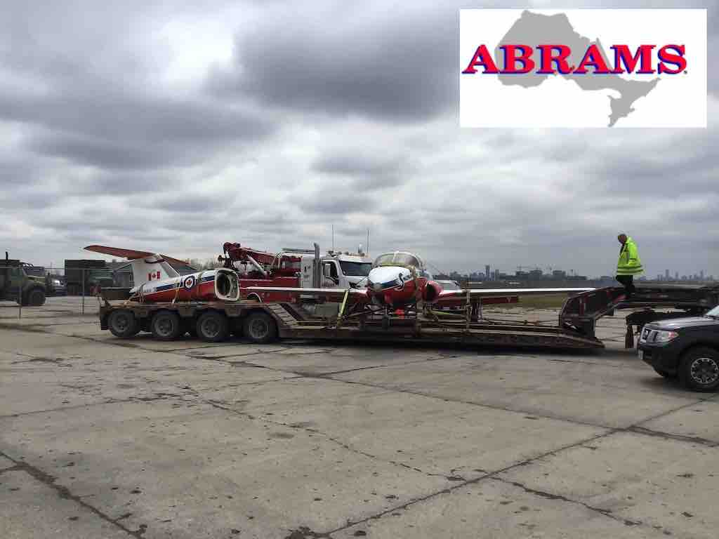 Snowbird sitting on flatbed after effort of heavy duty towing team