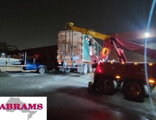 Heavy Tow Truck Lifts Semi Near Highway 7