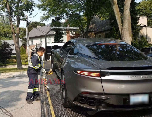 Towing an Aston Martin DBS using a Flatbed Tow Truck