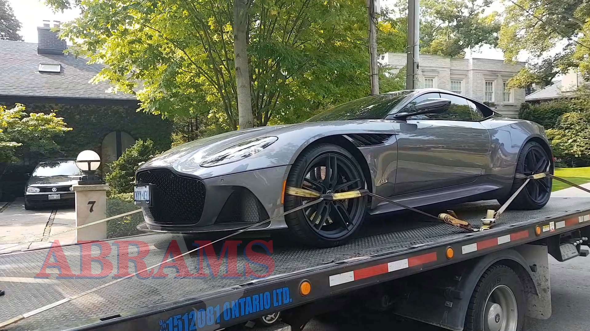 Towing an Aston Martin and securing the wheels using tow straps