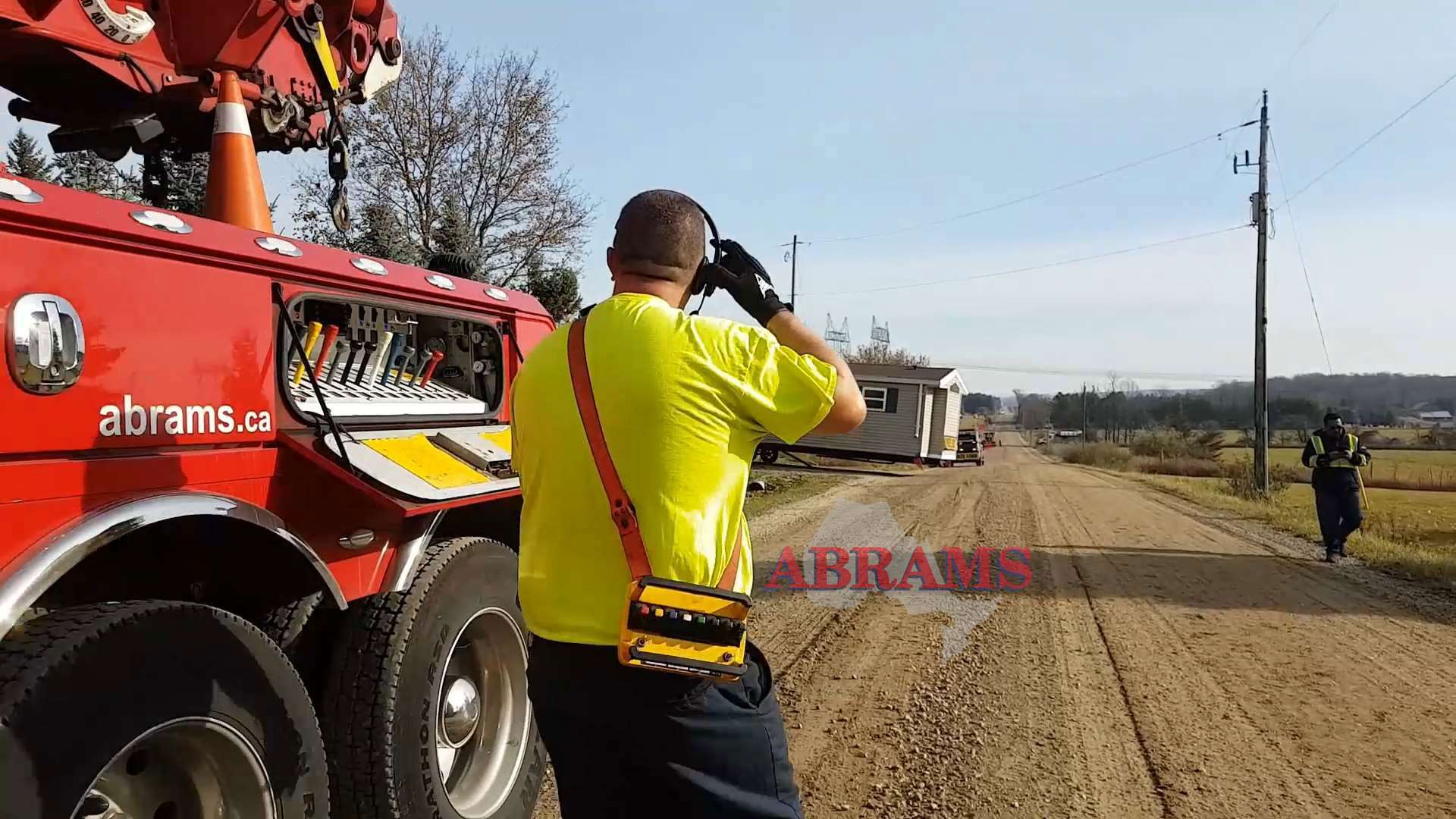 Tractor reverses onto the road and winch pulls trailer