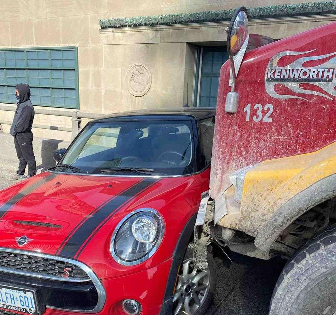 Mini Cooper towed after accident with dump truck
